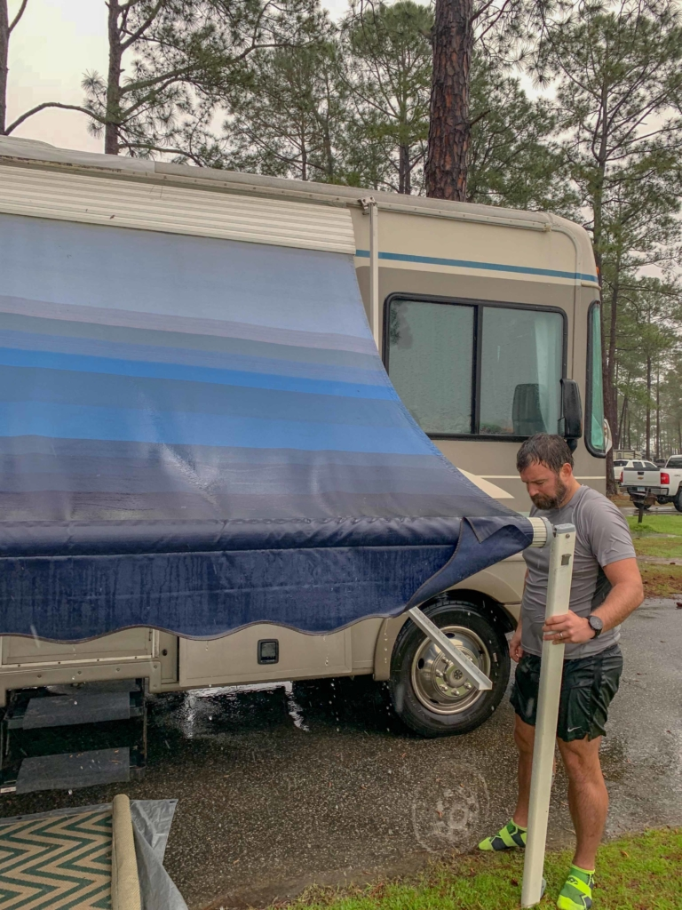 Fixing RV Awning during our stay at Meaher State Park